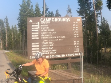 Erika being silly at Yellowstone. Campgrounds at National Parks in the US are pretty much always full. Luckily, if you're travelling on a bike there's always smaller hiker/biker sites available for a cheaper price! We had no problems finding campgrounds at Yellowstone despite everything being full for RVs