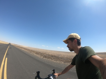 Long hot roads in Oregon riding through recently harvested wheatfields